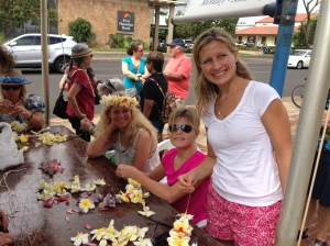 Learning to make plumeria leis with friends.